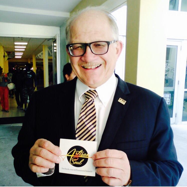 Mr. Rosenberg, President of FIU, holding Artisan Soul sticker